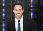 Businessman Standing In Front Of Server Racks
