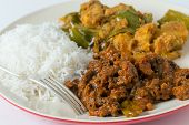 Indian roast beef curry with aloo capsicum, potato and bell pepper curry, and white rice.