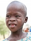 AFRICA, TANZANIA-FEBRUARY 9, 2014: Unidentified girl of Masai tribe looking to the camera on Februar