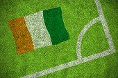 Ivory coast national flag against corner of football pitch