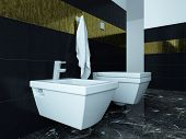Picture of toilet and bidet against black tiles