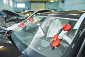 foto of car-window  - Automobile car windshield or windscreen service concept in auto service station garage - JPG