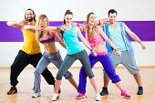 stock photo of dancing  - Group of men and women dancing fitness choreography in dance school - JPG