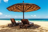 Wooden chairs and umbrellas on white sand beach at Phu Quoc island in Vietnam