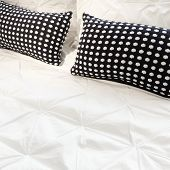 White Bed Linen With Black Cushions