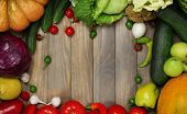 Fresh organic vegetables on wooden table, close up