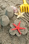 Flower-shaped  and castle-shaped sand, starfish and children toys close-up