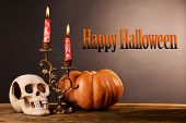 stock photo of bloody  - Bloody candles for Halloween holiday and decorative skull - JPG
