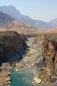 image of oman  - Water has cut through desert rock to create Wadi Dyqah one of the most beautiful natural landscapes in the Sultanate of Oman - JPG