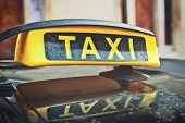 pic of car symbol  - Taxi Cab Car Roof Sign Close Up with selective focus - JPG