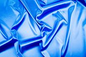 Closeup of elegant shiny blue silk.