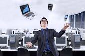 image of juggling  - Portrait of happy businessman juggling with business items in the office - JPG