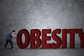Fat Man Pushing An Obesity Word