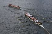 Georgetown University (R) and New York Athletic Club(L) races in the Head of Charles Regatta Men's C