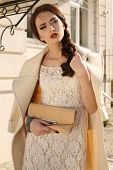 Beautiful Ladylike Woman With Dark Hair In Elegant Wool Coat