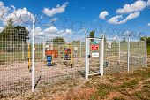 Gas Regulatory And Distribution Point In Summer Sunny Day. Text On Russian: Trespassing