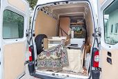 picture of moving van  - Interior of A Moving Van On Street With Household Furnishings - JPG