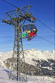 People On Ski  And Snowboards At Cable Car Cabin On Winter Sport Resort In Swiss Alps