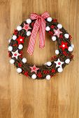 Decorated Christmas Door Wreath Red White Cloth Stars And Gingham Bow On Sapele Wood Background