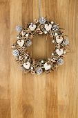 Decorated Christmas Door Wreath Birch Hearts And Pine Cones On Sapele Wood Background
