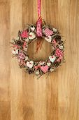Decorated Christmas Wreath Red White Cloth Hearts On Sapele Wood Background