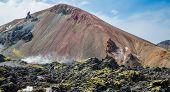 Tourists in Landmannalaugar unbelievable lava landscape, Iceland