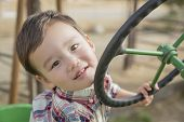 Adorable Mixed Race Young Boy Playing on the Tractor at the Pumpkin Patch.