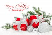 stock photo of fir  - Christmas baubles and red gift boxes with snow fir tree - JPG