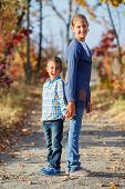 Cute kids in autumn park
