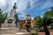Parque Duarte in the old part of Santo Domingo called Zona Colonial with colonial building in backgr