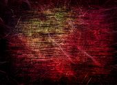 Red Grungy Scratched Multicolored Texture As Abstract Background.