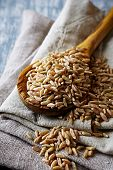 Organic spelt wheat on a wooden spoon