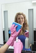 image of cleaning house  - Attractive woman cleaning bathroom - JPG