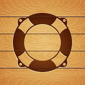 foto of marquetry  - Illustration of a lifebuoy on wooden background - JPG