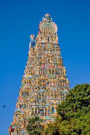 stock photo of meenakshi  - Colorful tower of Meenakshi Amman Temple in India - JPG