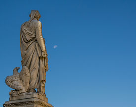 stock photo of alighieri  - Dante Alighieri statue by Enrico Pazzi in Santa Croce square in Florence - JPG