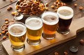 stock photo of porter  - Assorted Beers in a Flight Ready for Tasting - JPG