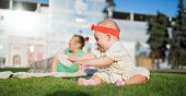 stock photo of crawling  - Happy babyHappy baby posing in front of a beautiful building in the city park - JPG