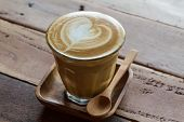 stock photo of chocolate spoon  - Cappuccino or latte coffee at the coffee shop.