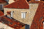 pic of yugoslavia  - Red roofs and stone facade of Budva in Montenegro at sunset - JPG