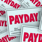 picture of paycheck  - Payday word on checks in a pile of earnings - JPG