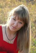 image of pagan  - Girl with a pendant in the form of Slavic pagan swastika  - JPG
