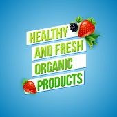 stock photo of blackberries  - Text design for Healthy Fresh Organic Products with green text in banners over a blue background decorated with fresh ripe strawberries and a blackberry - JPG