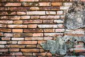 stock photo of deformed  - Old Deformed Brick Wall for using as background or texture. ** Note: Soft Focus at 100%, best at smaller sizes - JPG
