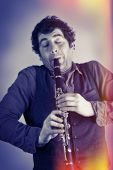 picture of clarinet  - Silly musician feels the music as he plays clarinet - JPG