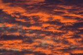 image of wispy  - Vivid sky features sunset colors and wispy clouds - JPG