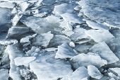 picture of frozen  - Big ice fragments covered with show on frozen river water - JPG