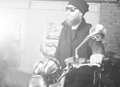 pic of chopper  - Hipster man with his chopper motorcycle posing - JPG