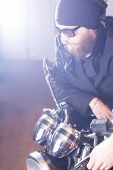 picture of chopper  - Portrait of a man and his chopper motorcycle - JPG