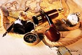 pic of spyglass  - Marine still life spyglass and world map on old wooden background - JPG